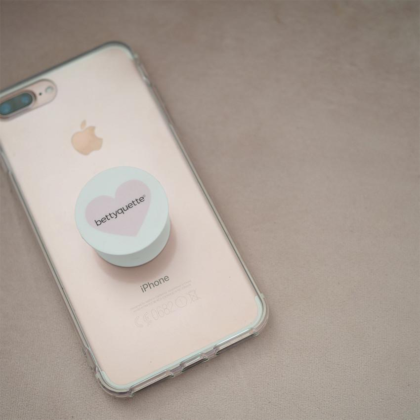 Give your hands a break with our cute as could be bettyquette pop socket. Suitable for all phone types, it makes holding your phone a breeze!